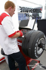 Bridgestone team member prepares the tires