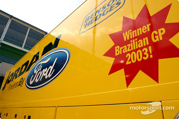 Team Jordan celebrate Brazilian GP victory on the transporter