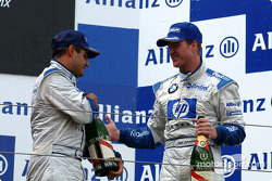 The podium: race winner Ralf Schumacher and Juan Pablo Montoya