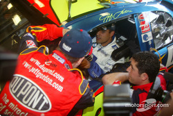 Jeff Gordon, left, offers advice to Juan Pablo Montoya