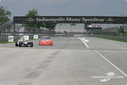 Jeff Gordon, left, and Juan Pablo Montoya veer into the left-hand turn at the end of the back straightaway at Indy