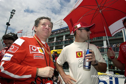 Jean Todt and Rubens Barrichello on the starting grid