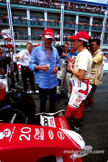 Olivier Panis and actor Jean Reno on the starting grid