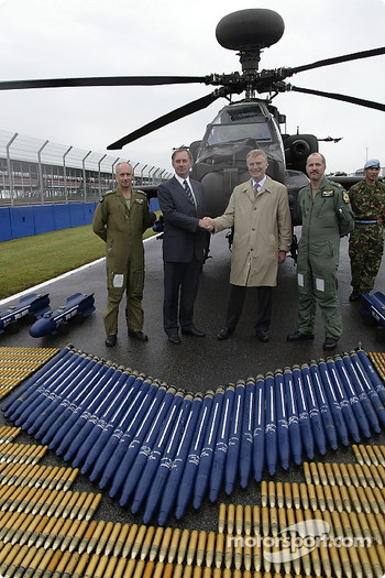 The Rt Hon. Geoff Hoon Secretary of State for Defence shakes hands with FIA President Max Mosley as Apache pilots Major Mick Manninng and Captain Bill McPhee