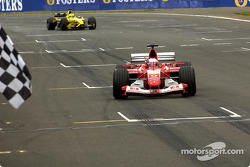 Rubens Barrichello takes the checkered flag