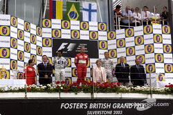 The podium: race winner Rubens Barrichello with Juan Pablo Montoya and Kimi Raikkonen