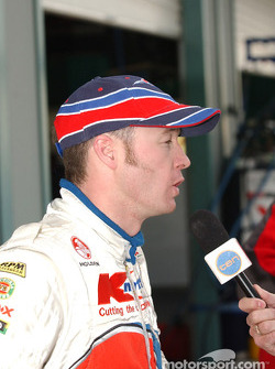 K-Mart driver Greg Murphy talks to the media after grabbing 2nd spot on the grid