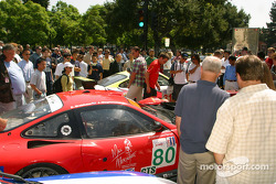 Fans take a close look at the #80 Prodrive Ferrari 550 Maranello and the #31 White Lightning-Petersen Motorsports Porsche 911 GT3 RS before they took some laps around San Jose's Cesar Chavez Park