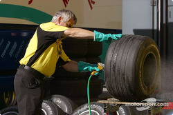 Jordan team member washes the tires