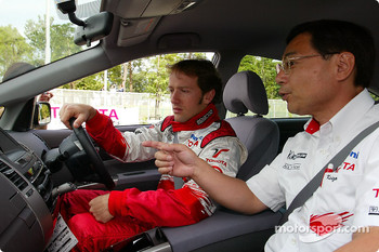 Megaweb event: Cristiano da Matta and Keizo Takahashi on board a new Toyota road car