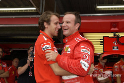 Rubens Barrichello celebrates pole with Luca Badoer