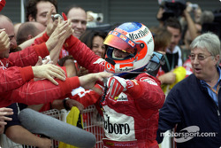 Rubens Barrichello celebrates win