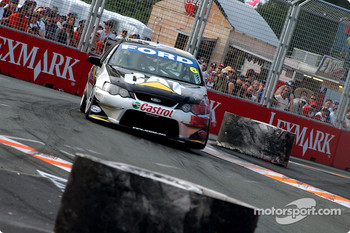 Craig Lowndes doing his best to avoid the tyres
