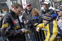 Matt Kenseth sigs an autograph for a young fan in Times Square