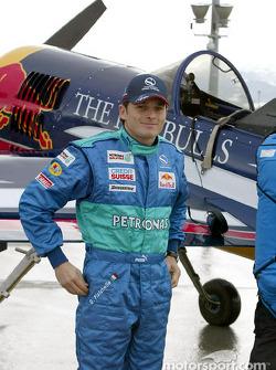 Giancarlo Fisichella arrives at Red Bull's Hangar-7 at Salzburg Airport