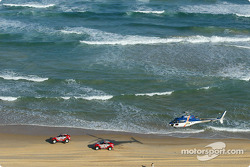 Stéphane Peterhansel and Jean-Paul Cottret, Hiroshi Masuoka and Gilles Picard cruise to a 1-2 finish on the beach of Dakar