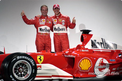 Rubens Barrichello and Michael Schumacher with the new Ferrari F2004