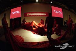Ferrari team members prepare the stage