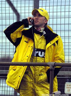 Nick Heidfeld makes a phonecall