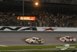 Dale Jarrett takes the the checkered flag in front of Dale Earnhardt Jr.
