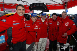 Podium: winners Sébastien Loeb and Daniel Elena celebrate with team members