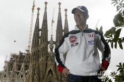 Takuma Sato in front of Antoni Gaudi's Temple de La Sagrada Familia