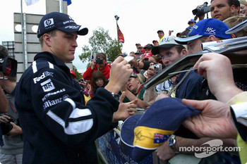Ralf Schumacher signs autographs