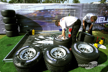 Toyota team members prepare the tires