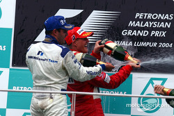 Podium: champagne for Juan Pablo Montoya and Michael Schumacher
