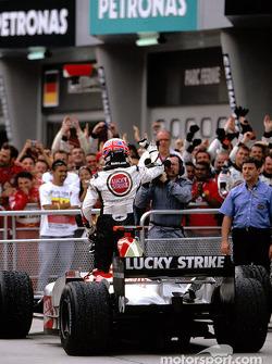 Jenson Button celebrates third place finish