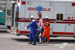 Kyle Busch walks to the emergency vehicle