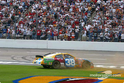 Race winner Elliott Sadler tears up the grass