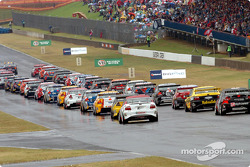 Drivers commence with a rolling start due to the rain