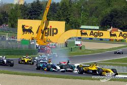 Giorgio Pantano battles with Giancarlo Fisichella and Christian Klien