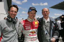 Mattias Ekström celebrates pole position with race engineer Alex Stehlig and head of Audi Motorsport Dr Wolfgang Ullrich