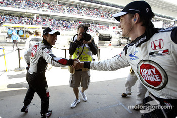 Takuma Sato congratulaed by Jenson Button for his third place qualifying