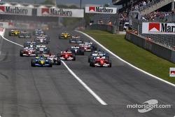Start: Jarno Trulli takes the lead ahead of Michael Schumacher and Takuma Sato
