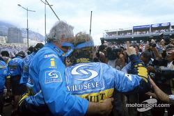 Jarno Trulli celebrates victory with Flavio Briatore