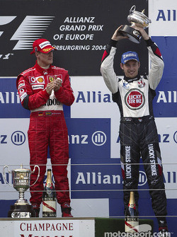 Podium: race winner Michael Schumacher with Jenson Button
