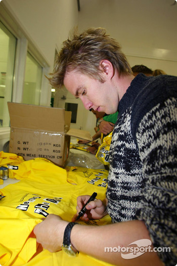 Nick Heidfeld signs autographs for Sport Relief