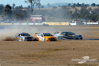 Mark Winterbottom and Warren Luff tangles at the half way stage