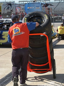 Tide Racing crewman transports another set of tires to the pits