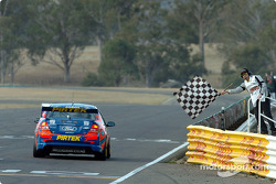 Marcos Ambrose takes the chequered flag and wins the round