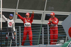 Jenson Button, Michael Schumacher and Rubens Barrichello head to podium