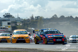 Marcos Ambrose got the jump on Rick Kelly at the start