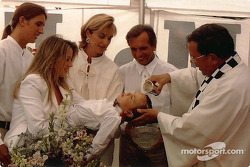 Father Phil De Rea christens Luca Fittipaldi