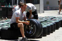 Mclaren mechanic with a Bridgestone tyre