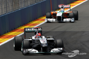 Michael Schumacher, Mercedes GP leads Adrian Sutil, Force India F1 Team