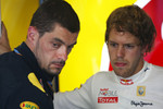 Sebastian Vettel, Red Bull Racing talks with Guillaume Rocquelin his engineer