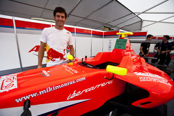 Mark Webber, Red Bull Racing RB6 Renault, with the car of Miki Monras visiting the MW Arden team
